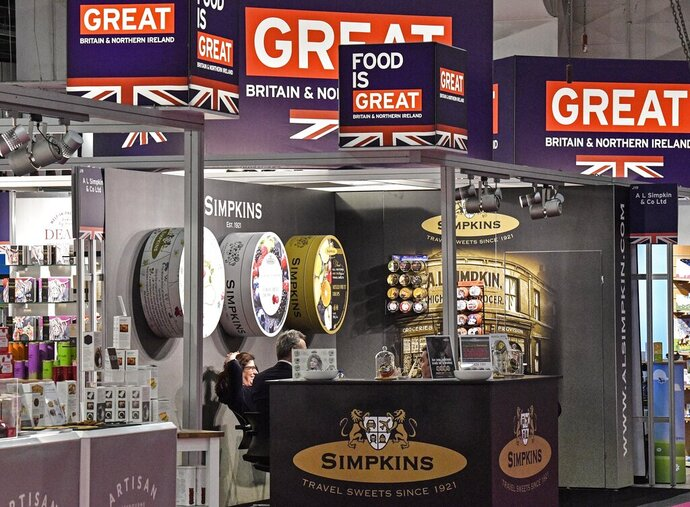 British candy producers show their products at the international candy fair ISM in Cologne, Germany, Wednesday, Jan. 30, 2019. Approx. 5 % of German production of sweets, with a value of around 800 million Euro, is exported to the important United Kingdom market. (AP Photo/Martin Meissner)