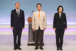 FILE - In this Dec. 29, 2019, file photo, Taiwan's 2020 presidential election candidates, from right, Democratic Progressive Party's Tsai Ing-wen, People First Party's James Soong, and Nationalist Party's Han Kuo-yu pose for a picture at the start of their televised policy debate in Taipei, Taiwan. A year ago, Taiwan's leader was on the ropes. Then she got a boost from an unexpected corner: Chinese President Xi Jinping. Polls indicate that President Tsai Ing-wen is poised to win a second four-year term, a remarkable turnaround for a leader whose future was in doubt after voters dealt her Democratic Progressive Party a major loss in November 2018 local elections. (Pool Photo via AP, File)