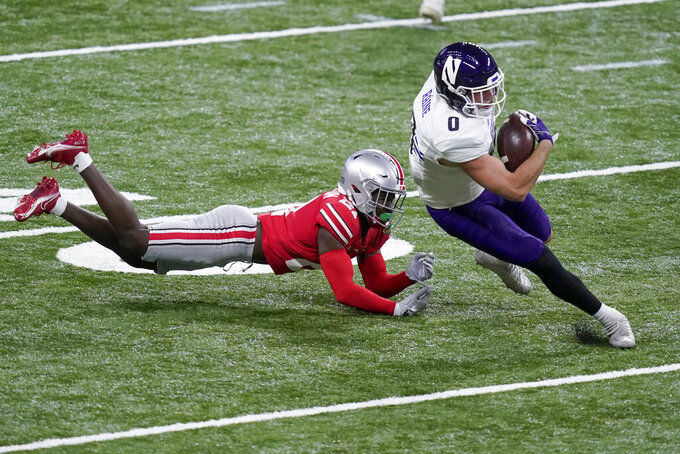 Northwestern tight end John Raine (0) runs with the ball past Ohio State cornerback Marcus Williamson during the first half of the Big Ten championship NCAA college football game, Saturday, Dec. 19, 2020, in Indianapolis. (AP Photo/Darron Cummings)