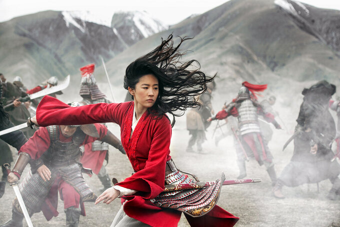 """This image released by Disney shows Yifei Liu in the title role of """"Mulan.""""  (Jasin Boland/Disney via AP)"""