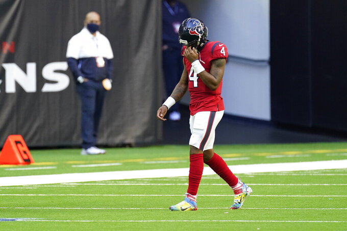 Houston Texans quarterback Deshaun Watson (4) walks off the field after he was sacked for a safety during the second half of an NFL football game against the Indianapolis Colts, Sunday, Dec. 6, 2020, in Houston. (AP Photo/David J. Phillip)