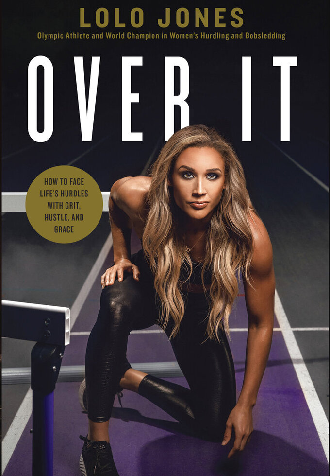 """This image provided by Thomas Nelson publishing shows the cover of Lolo Jones's book, """"Over It."""" Jones doesn't start with her biggest accomplishment. Instead, she opens with the """"most painful race"""" of her career—the 100-meter hurdles at the 2008 Beijing Olympics. (Thomas Nelson via AP)"""