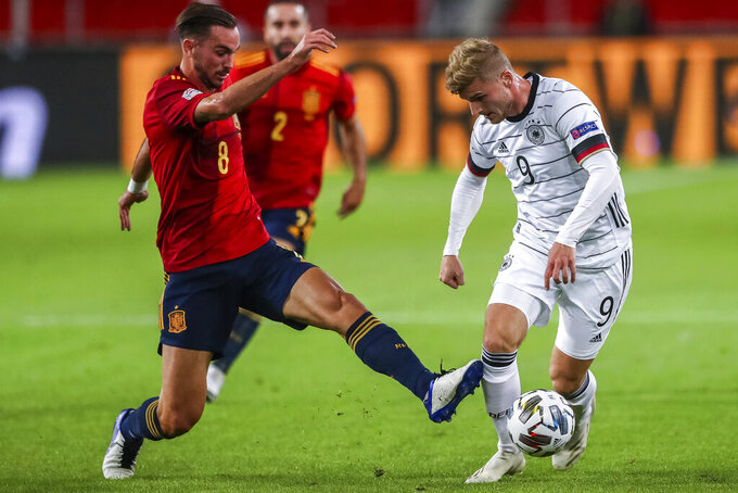 Germany's Timo Werner, right, duels for the ball with Spain's Fabian Ruiz during their UEFA Nations League soccer match at the Mercedes-Benz Arena stadium in Stuttgart, Germany, Thursday, Sept. 3, 2020. (AP Photo/Matthias Schrader)