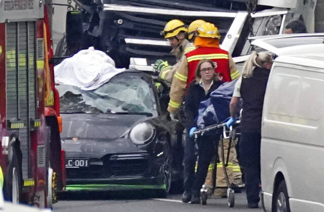 Emergency services work at the scene of a collision near the Chandler Highway in the suburb of Kew in Melbourne, Thursday, April 23, 2020. Officials say a truck has killed four police officers who had detained a drug-affected speeding driver in a collision on an Australian freeway. Victoria Police Chief Commissioner Graham Ashton says the driver of a Porsche 911 who had been pulled over in Melbourne for speeding on Wednesday evening took grisly photos of the crash scene that followed, The driver then fled on foot and posted the images online. He was arrested.(Scott Barbour/AAP Image via AP)