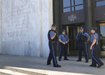 Oregon State Police officers guard the entrance to the Oregon State Capitol in Salem, Ore., Saturday, June 29, 2019. Nine of the 12 minority Republicans returned after Senate President Peter Courtney said the majority Democrats lacked the votes to pass the legislation aimed at countering climate change.  ( AP Photo/Andrew Selsky)