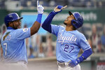 Kansas City Royals Adalberto Mondesi (27) celebrates with teammate Maikel Franco (7) after his solo home run during the first inning of a baseball game against the Detroit Tigers at Kauffman Stadium in Kansas City, Mo., Saturday, Sept. 26, 2020. (AP Photo/Orlin Wagner)