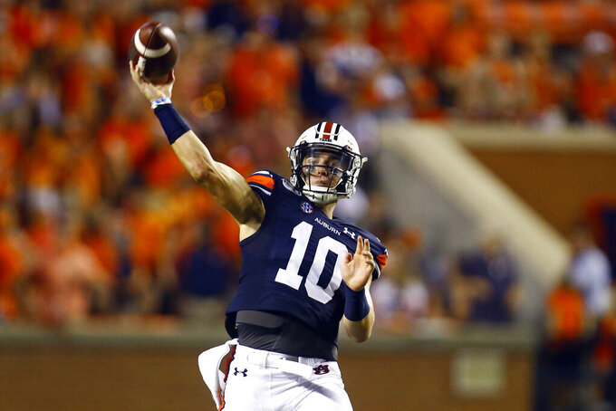 Auburn quarterback Bo Nix (10) throws a pass during the second half of an NCAA college football game against Mississippi State, Saturday, Sept. 28, 2019, in Auburn, Ala. (AP Photo/Butch Dill)