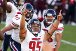 FILE - In this Saturday, Nov. 7 2020, file photo, Liberty's Alex Barbir (95) celebrates kicking the game-winning field goal in the last second of the fourth quarter of an NCAA college football game against Virginia Tech in Blacksburg, Va. An unusual college football season has produced some unexpected unbeaten teams dotting the AP Top 25 with about a month left. Led by No. 7  Cincinnati and No. 8 BYU, five teams from outside the Power Five conferences have yet to lose. (Matt Gentry/The Roanoke Times via AP, Pool, File)