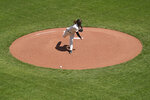 San Francisco Giants starting pitcher Johnny Cueto works in the first inning of a baseball game against the Colorado Rockies, Friday, April 9, 2021, in San Francisco. (AP Photo/Eric Risberg)