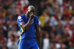 Chelsea's Romelu Lukaku reacts after scoring his side's first goal during the English Premier League soccer match between Arsenal and Chelsea at the Emirates stadium in London, England, Sunday, Aug. 22, 2021. (AP Photo/Ian Walton)