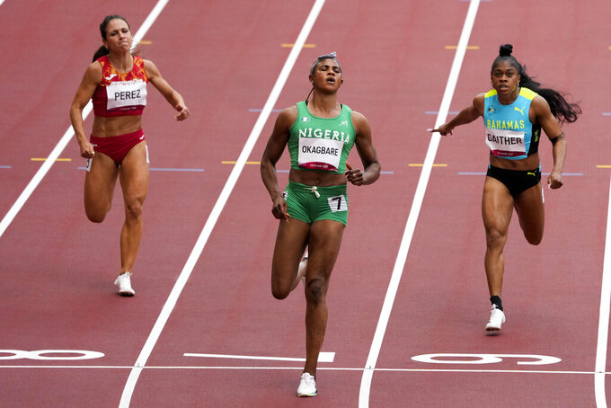 Blessing Okagbare, of Nigeria, wins a heat in the women's 100-meter run at the 2020 Summer Olympics, Friday, July 30, 2021, in Tokyo. (AP Photo/Charlie Riedel)