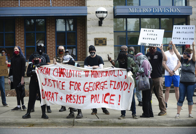 Protesters rally in front of the Charlotte-Mecklenburg Police Department-Metro Division station protesting the death of George Floyd in Minneapolis on Friday, May 29, 2020, in Charlotte, N.C.  (David T. Foster III/The Charlotte Observer via AP)