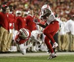 Nebraska's JD Spielman gets away from Wisconsin's Madison Cone during the second half of an NCAA college football game Saturday, Oct. 6, 2018, in Madison, Wis. (AP Photo/Morry Gash)