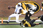 Kentucky quarterback Terry Wilson (3) runs past Missouri defensive lineman Chris Turner (39) during the second half of an NCAA college football game Saturday, Oct. 24, 2020, in Columbia, Mo. (AP Photo/L.G. Patterson)