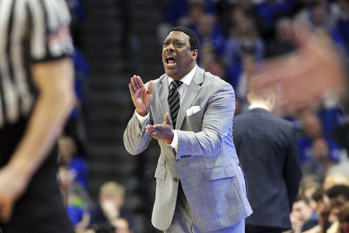 FILE - In this Feb. 28, 2018, file photo, Mississippi acting head coach Tony Madlock reacts during the second half of an NCAA college basketball game against Kentucky in Lexington, Ky. South Carolina State has hired Madlock as men's basketball head coach. Bulldogs athletic director Stacy L. Danley announced the move Thursday, March 25, 2021. (AP Photo/James Crisp, File)
