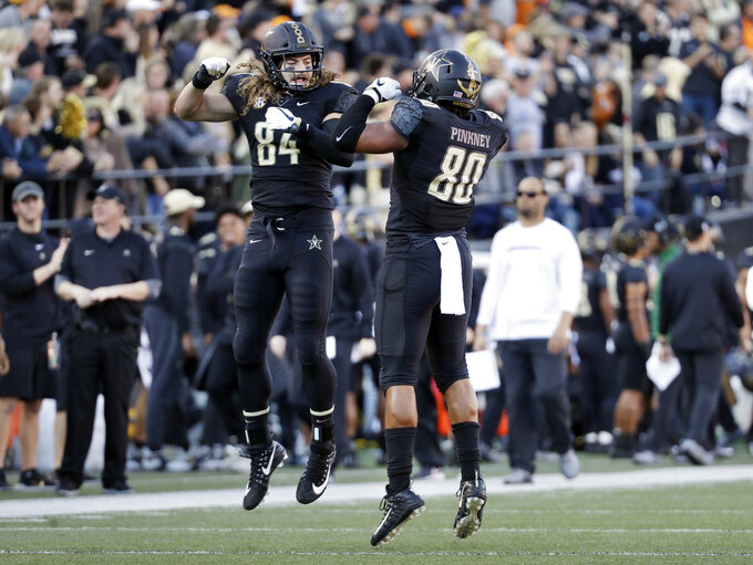 Vanderbilt tight end Jared Pinkney (80) celebrates with tight end Sam Dobbs (84) after scoring a touchdown on a 17-yard pass against Tennessee in the first half of an NCAA college football game Saturday, Nov. 24, 2018, in Nashville, Tenn. (AP Photo/Mark Humphrey)