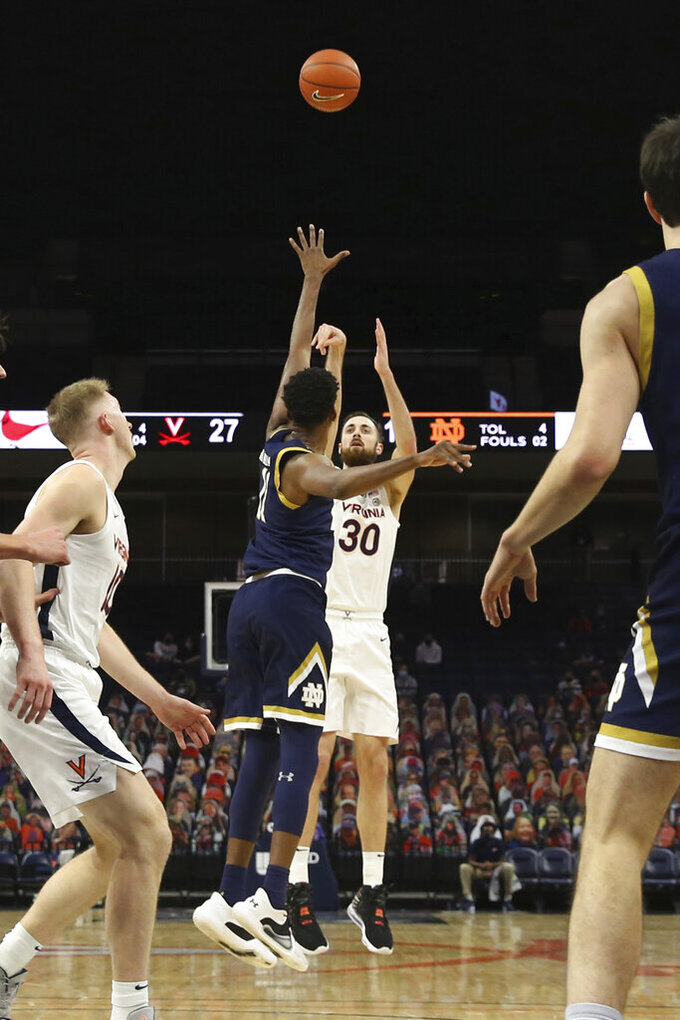 Virginia forward Jay Huff (30) shoots during an NCAA college basketball game against Notre Dame Wednesday, Jan. 13, 2021, in Charlottesville, Va. (Erin Edgerton/The Daily Progress via AP, Pool)