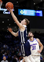 Butler guard Paul Jorgensen, left, drives to the basket past DePaul guard Max Strus during the first half of an NCAA college basketball game Wednesday, Jan. 16, 2019, in Chicago. (AP Photo/Nam Y. Huh)