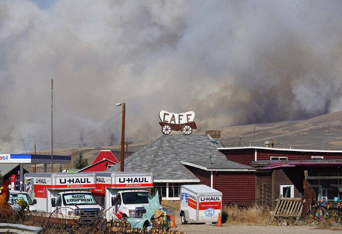 Smoke rises from mountain ridges as a wildfire burns south of Highway 34 Thursday, Oct. 22, 2020, near Granby, Colo. (AP Photo/David Zalubowski)