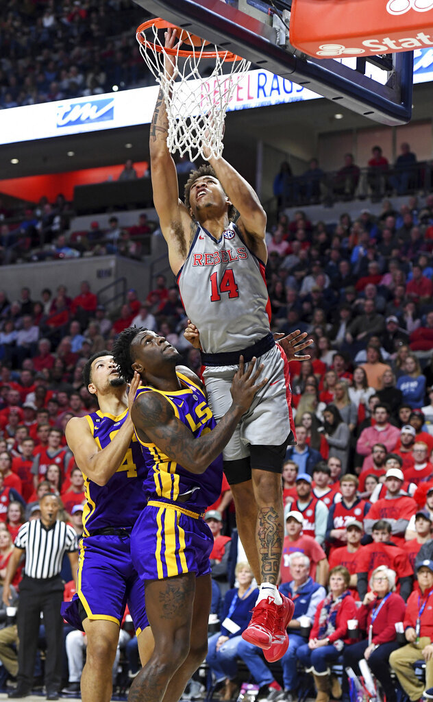 Mississippi forward KJ Buffen (14) shoots over LSU forward Emmitt Williams (24) and guard Skylar Mays (4) during the first half of an NCAA college basketball game in Oxford, Miss., Tuesday, Jan. 15, 2019. (AP Photo/Thomas Graning)