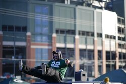 A fan tailgates outside Lambeau Field before an NFL football game between the Green Bay Packers and the Chicago Bears Sunday, Dec. 15, 2019, in Green Bay, Wis. (AP Photo/Matt Ludtke)
