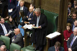 In this handout photo provided by UK Parliament, Speaker of the House John Bercow, centre, talks, during the Brexit debate in the House of Commons, London, Thursday March 14, 2019. Britain's Parliament has voted to seek a delay of the country's departure from the European Union, a move that will likely avert a chaotic withdrawal on the scheduled exit date of March 29.  (UK Parliament/Jessica Taylor via AP)