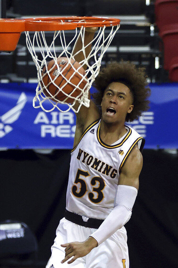 Wyoming guard Xavier DuSell (53) dunks during the second half of an NCAA college basketball game against San Jose State in the first round of the Mountain West Conference men's tournament Wednesday, March 10, 2021, in Las Vegas. (AP Photo/Isaac Brekken)