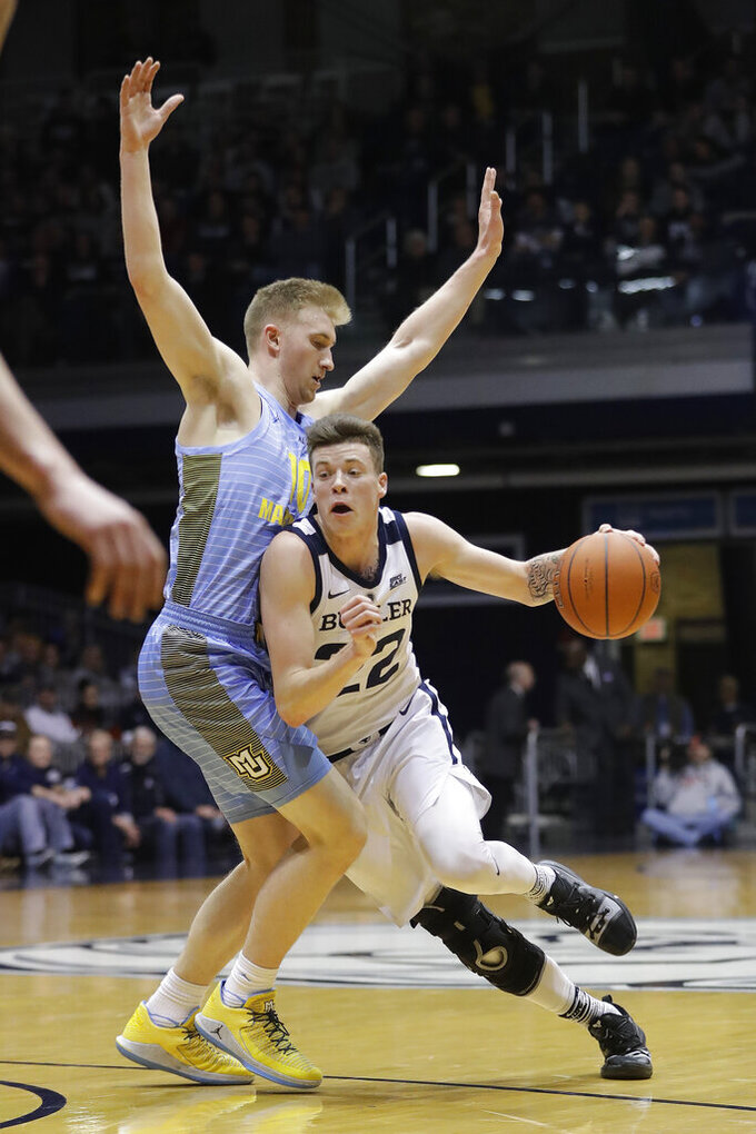 Butler's Sean McDermott (22) goes to the basket against Marquette's Sam Hauser (10) during the first half of an NCAA college basketball game, Wednesday, Jan. 30, 2019, in Indianapolis. (AP Photo/Darron Cummings)