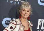 """FILE - Rita Moreno arrives at the 25th annual Critics' Choice Awards on Jan. 12, 2020 in Santa Monica, Calif. Moreno, an EGOT (Emmy, Grammy, Oscar, Tony) winner whose career spans over seven decades says she has seen huge progress for women and other minorities in Hollywood but is still """"mightily and profoundly"""" concerned about why Hispanics haven't gotten a hold on their profession. (Photo by Jordan Strauss/Invision/AP, File)"""
