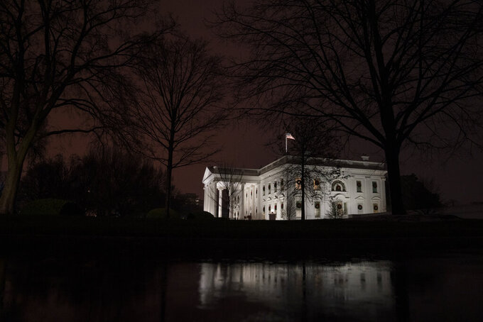 FILE - This Dec. 16, 2020, file photo shows a view of the White House in Washington. In the six weeks since his defeat by Biden, Trump has been increasingly disengaged from his job. (AP Photo/Evan Vucci, File)