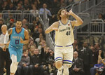 Milwaukee Bucks' Robin Lopez (42) reacts after his 3-point basket against the Charlotte Hornets during the first half of an NBA basketball game Saturday, Nov. 30, 2019, in Milwaukee. (AP Photo/Jeffrey Phelps)