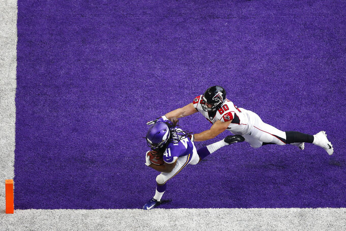 Minnesota Vikings defensive back Anthony Harris (41) intercepts a pass intended for Atlanta Falcons tight end Luke Stocker in the end zone during the second half of an NFL football game, Sunday, Sept. 8, 2019, in Minneapolis. (AP Photo/Bruce Kluckhohn)