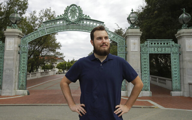 University of California at Berkeley graduate Tyler Lyson stands in front of Sather Gate on the closed Cal campus in Berkeley, Calif., on Monday, May 11, 2020. For the Class of 2020, the future looks grim. The pandemic has shattered the economy and the high hopes of graduates who, until recently, seemed all but assured of success. (AP Photo/Ben Margot)
