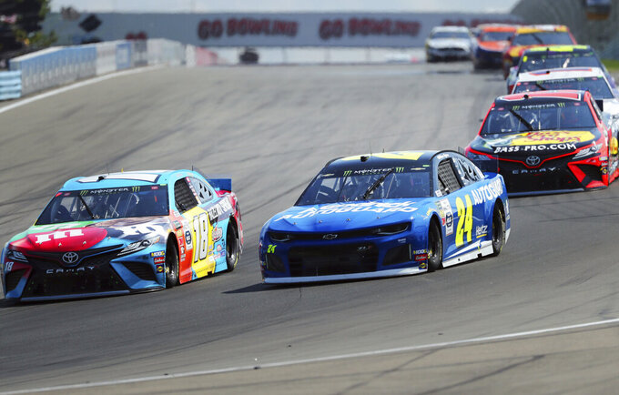 Kyle Busch (18) and William Byron (24) head into Turn 1 during a NASCAR Cup Series auto race at Watkins Glen International, Sunday, Aug. 4, 2019, in Watkins Glen, N.Y. (AP Photo/John Munson)