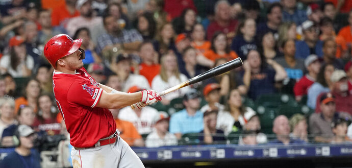 Los Angeles Angels' Mike Trout hits a home run against the Houston Astros during the eighth inning of a baseball game Friday, July 5, 2019, in Houston. (AP Photo/David J. Phillip)