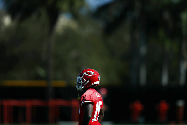 Kansas City Chiefs wide receiver Tyreek Hill (10) looks on during practice, Wednesday, Jan. 29, 2020, in Davie, Fla., for the NFL Super Bowl 54 football game. (AP Photo/Brynn Anderson)