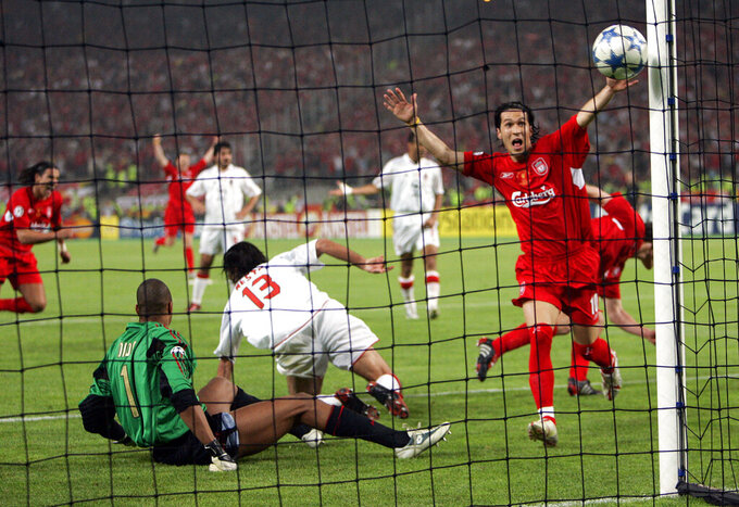 """FILE - In this Wednesday, May 25, 2005 file photo, Liverpool's Luis Garcia, right, celebrates after his teammate Xabi Alonso, behind him at right, scored his team's 3rd goal, during the Champions League Final between AC Milan and Liverpool at the Ataturk Olympic Stadium in Istanbul, Turkey. M is for Miracle, as in the Miracle of Istanbul. 3-0 down at halftime, Liverpool looked finished. But in an incredible six-minute period early in the second half, Liverpool, inspired by captain Steven Gerrard, had erased the deficit. The match ended up going to a penalty shootout, which Liverpool won to claim its fifth European Cup in the """"The Miracle of Istanbul."""" (AP Photo/Thomas Kienzle, File)"""
