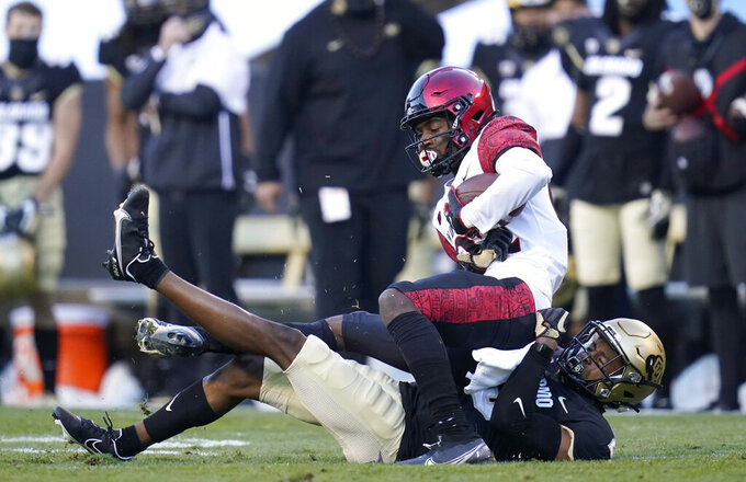 Colorado cornerback Mekhi Blackmon, bottom, pulls down San Diego State wide receiver Kobe Smith during the first half of an NCAA college football game Saturday, Nov. 28, 2020, in Boulder, Colo. (AP Photo/David Zalubowski)