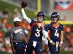 Denver Broncos quarterback Drew Lock, front, warms up as quarterback Brett Rypien looks on during an NFL football training camp practice at the team's headquarters Tuesday, July 30, 2019, in Englewood, Colo. (AP Photo/David Zalubowski)