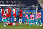 Barcelona's Lionel Messi, center right, shoots a free kick during the pre-season friendly soccer match between Barcelona and Girona at the Johan Cruyff Stadium in Barcelona, Spain, Wednesday, Sept. 16, 2020. (AP Photo/Joan Monfort)