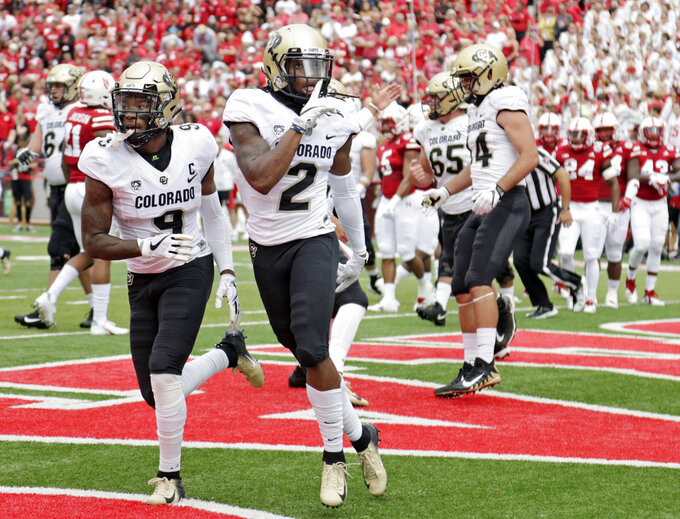 FILE - In this Sept. 8, 2018, file photo, Colorado wide receiver Laviska Shenault Jr. (2) gestures after he scored a touchdown against Nebraska during the first half of an NCAA college football game in Lincoln, Neb. Shenault is the nation's leading receiver and plays for an undefeated Power Five team, yet he remains something of an afterthought in a Heisman conversation that has been dominated by quarterbacks such as Alabama's Tua Tagovailoa and Ohio State's Dwayne Haskins thus far. Part of the problem is that Colorado has played a relatively soft schedule, due to Nebraska and UCLA having down seasons. (AP Photo/Nati Harnik, File)