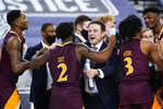 Iona head coach Rick Pitino, right, celebrates with Asante Gist after winning an NCAA college basketball game against Fairfield during the finals of the Metro Atlantic Athletic Conference tournament, Saturday, March 13, 2021, in Atlantic City, N.J. (AP Photo/Matt Slocum)