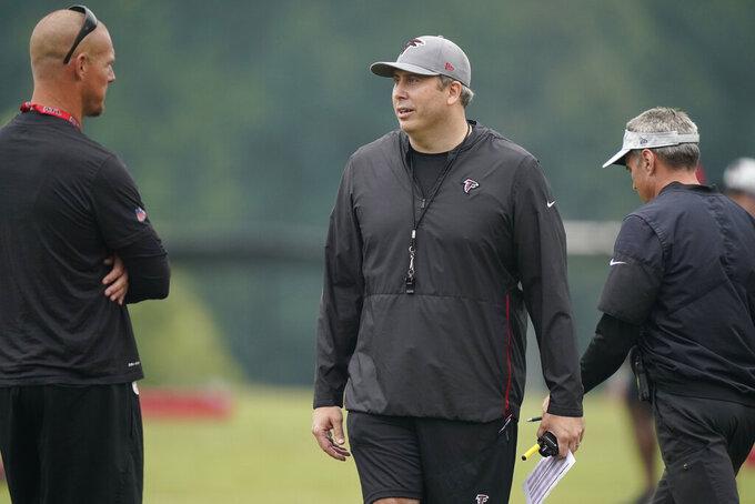 Atlanta Falcons head coach Arthur Smith walk on the field during NFL football practice on Tuesday, Aug. 3, 2021, in Flowery Branch, Ga. (AP Photo/Brynn Anderson)