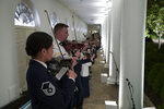 A military band plays on the Colonnade during a media preview for the State Dinner with President Donald Trump and Australian Prime Minister Scott Morrison in the Rose Garden of the White House, Thursday, Sept. 19, 2019, in Washington. (AP Photo/Alex Brandon)