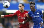 Liverpool's Virgil van Dijk, left, and Chelsea's Tammy Abraham go for the ball during the British Premier League soccer match between Chelsea and Liverpool, at the Stamford Bridge Stadium, London, Sunday, Sept. 22, 2019. (AP Photo/Frank Augstein)