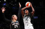 Seattle Storm center Ezi Magbegor (13) drives to the basket against New York Liberty forward Kylee Shook (24) during the first half of a WNBA basketball game Friday, Aug. 20, 2021, in New York. (AP Photo/Noah K. Murray)