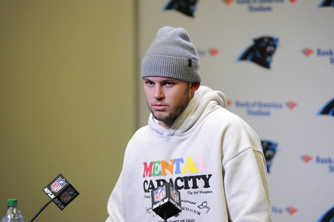 Carolina Panthers quarterback Kyle Allen speaks to the media following an NFL football game against the Seattle Seahawks in Charlotte, N.C., Sunday, Dec. 15, 2019. (AP Photo/Mike McCarn)