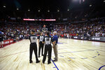 FILE - In this Friday, July 5, 2019 file photo Officials confer after an NBA summer league basketball game between the New York Knicks and the New Orleans Pelicans was stopped following an earthquake , in Las Vegas.   An earthquake that struck Southern California on Friday night forced the NBA to cancel the finish  two Summer League games, including the marquee sold-out matchup between New Orleans and New York, while engineers checked to see if the integrity of the Thomas & Mack Center on UNLV's campus was compromised in any way by the tremors.  (AP Photo/Steve Marcus)