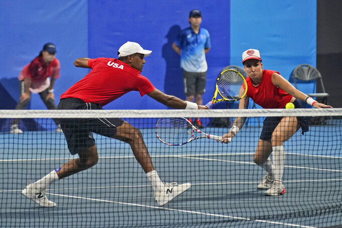 United States mixed doubles team of Bethanie Mattek-Sands, right, and Rajeev Ram play a German team during the first round of the tennis competition at the 2020 Summer Olympics, Wednesday, July 28, 2021, in Tokyo, Japan. (AP Photo/Seth Wenig)