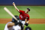 Washington Nationals' Austin Voth (50) pitches to Miami Marlins' Jorge Alfaro during the first inning of a baseball game, Sunday, Sept. 22, 2019, in Miami. (AP Photo/Wilfredo Lee)